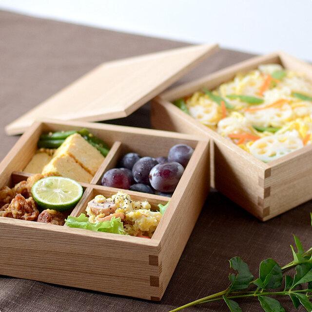 「かもめ食堂」で有名な荻上直子監督の映画「めがね」で、みんなでお弁当を食べるシーンがありましたが、 その時に使われていたのが、この松屋漆器店の重箱です。
