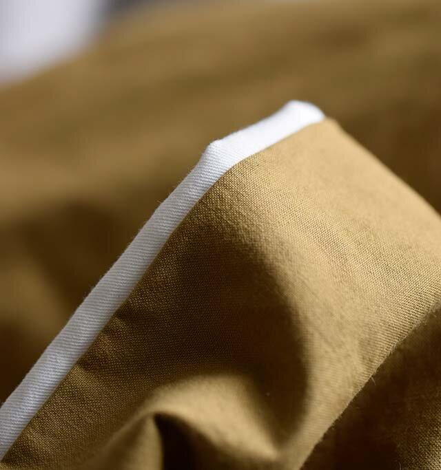 こちらの商品は表地と裏地を袋縫いで仕上げています。そのため写真のように表地から裏地が見えることがありますが、着用することにより差が縮まり、ふんわりとふくらんだような風合いなります。 個体によっては裏地の見え幅が異なる場合がございますが、あらかじめご了承ください。