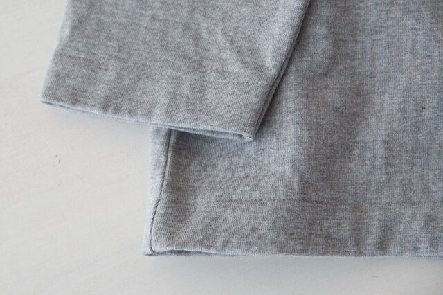 こだわりの9分袖。腕まくりしないで作業ができる!茶碗洗いだって袖が濡れません。