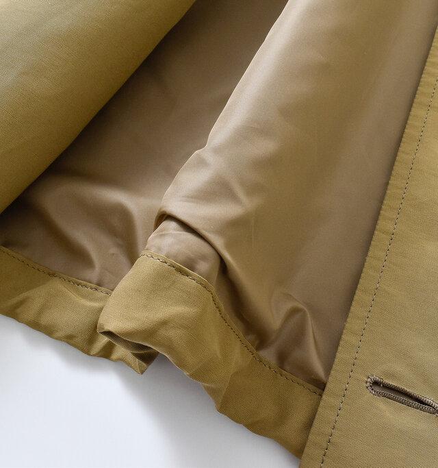 内側はポリエステルの裏地付き。するっと袖通しがよく、保温性もキープしてくれます。